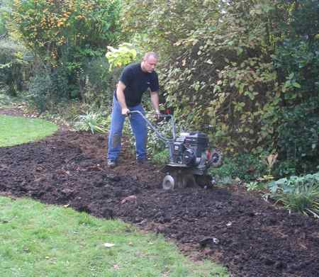 The author using the best garden tiller for the job
